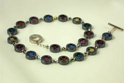 Hematite 'Donuts' filled with Swarovski cubes
